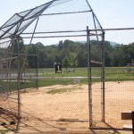 Baseball field chain link fencing behind home plate