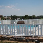White vinyl fence around built-in swimming pool